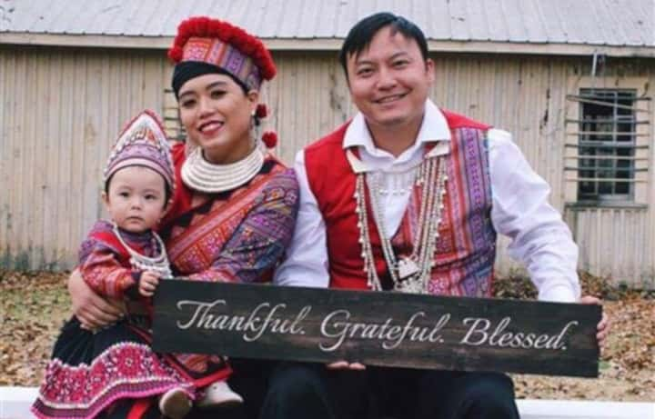 Kairi with her mother and father in Hmong traditional clothing.